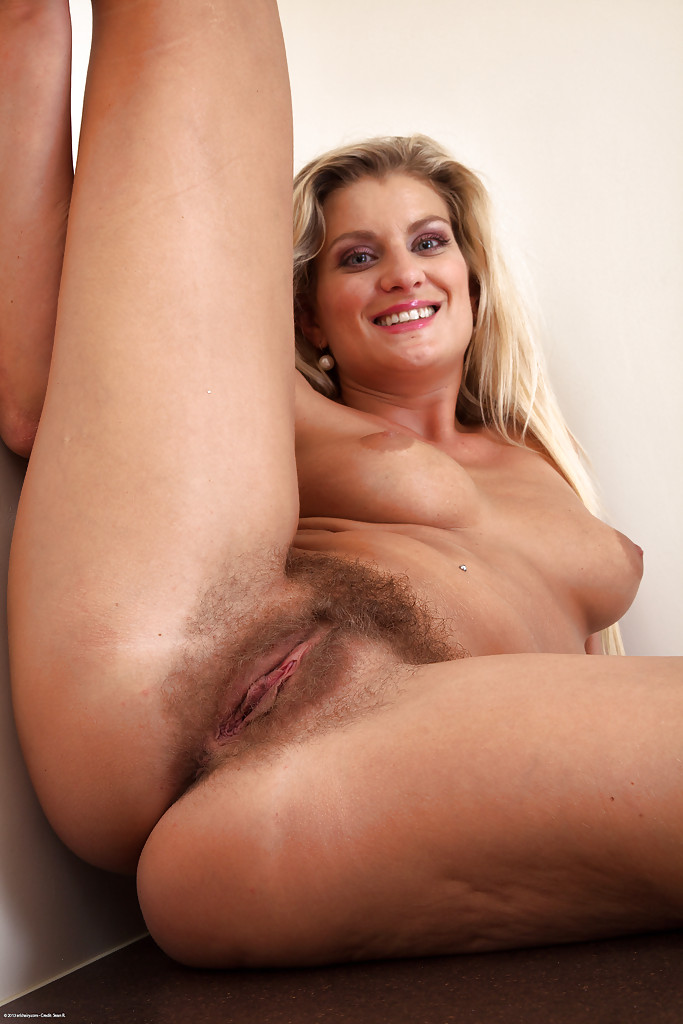 Mature blond hairy pussy